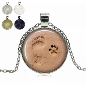 Footprint and paw in the sand glass dome necklace